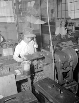 Bordeaux [Company employee working on an unidentified machine]