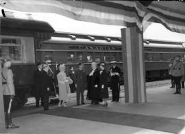 [Mayor and Mrs. Lyle J. Telford greet King George VI and Queen Elizabeth at C.P.R. Station]