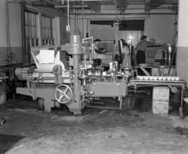 [Butter wrapping machine at a food plant]