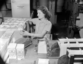 [Woman packaging napkins at Westminster Paper]