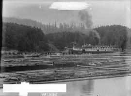 "[Log booms, and the ferry S.S. ""Bowena"" in Snug Cove, Bowen Island]"