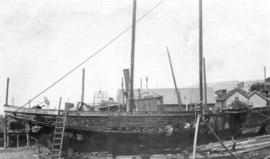 [A boat burned during the fire at Wallace Shipyards]