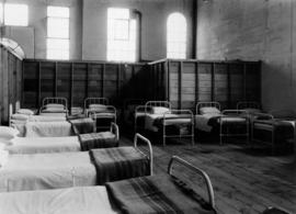 Infirmary beds, likely in hospital in Livestock building, Building A, during Japanese Canadian in...
