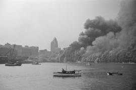 "[View of Pier ""D"" engulfed in smoke and flames]"