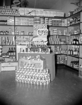 [Burns' canned meat and Bendix Home Laundry display in a grocery store]