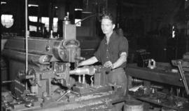 [Man with equipment at Canadian Summer Iron Works]