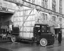 Terminal Cartage Company truck unloading plate glass at Spencers [Department store]