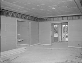 [Interior view of a room in a building under construction or renovation showing gyproc on the walls]
