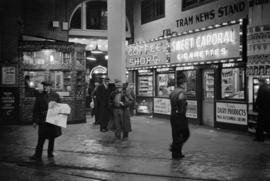 [The Tram News Stand and Coffee Shop illuminated at night in the B.C. Electric Building at 425 Ca...