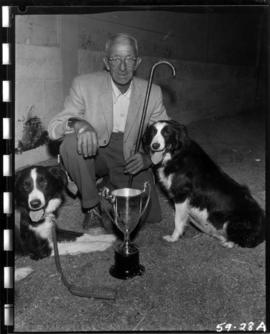 Man with award winning Border collies in 1959 P.N.E. dog show