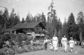 [People walking and sitting by the Pavilion at Stanley Park]