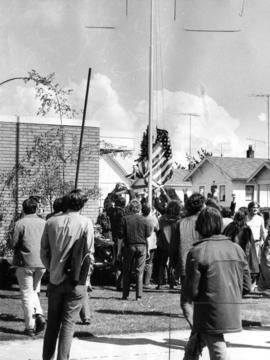 Demonstrators pulling down American flag in Blaine, Washington