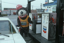 Tillicum pumping gas at Chevron station on 4th Avenue and Macdonald Street