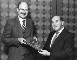 Mike Harcourt hands corporate appreciation award to Peter Paul Saunders