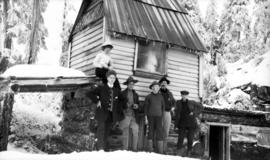 [Group of men in front of] shack on plateau [on] Grouse [Mountain]
