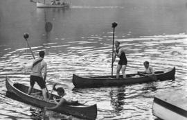 "[""Tilting"" in canoes in the North Arm of Burrard Inlet]"