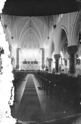 [Interior of Holy Rosary Cathedral, showing centre aisle, pews, and altar]