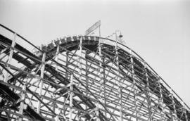 [Cars at the top of the Giant Dipper roller coaster at the Pacific National Exhibition midway at ...