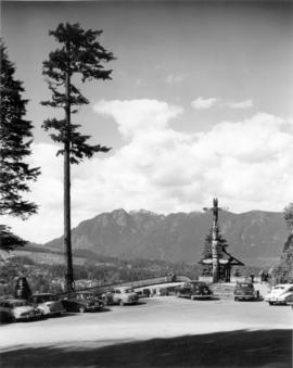 [Prospect Point showing totem pole, automobiles, mountains and north shore in the distance]