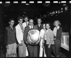 Award winners pose with trophy from 1957 P.N.E. 4-H and Future Farmers of Canada competition