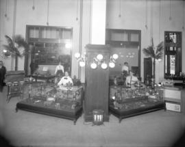 [Men and women in B.C. Electric Railway Company showroom in head office building, Carrall Street]