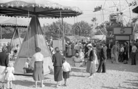 [Children's rides at the Pacific National Exhibition midway at Hastings Park]
