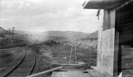 View of IMPOCO railway siding, storage tanks, at Asher