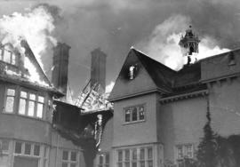 [The roof of Government House ablaze]