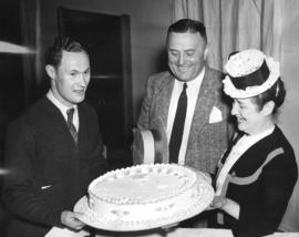 [H.J. Christison, Leo Sweeney and Miss Margaret McNeil admire a diamond jublilee cake at Shaughne...