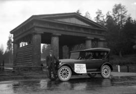 """Reo Six"" [automobile] leaving Vancouver for New Brunswick [at Lumberman's Arch]"