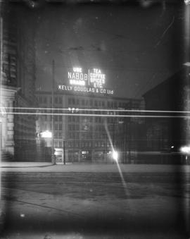 [Illuminated sign for coffee and tea at Kelly Douglas and Co. Ltd. at Hastings and Richards Streets]