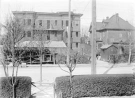 [View of Pender Street, showing house and Seaton apartment building]