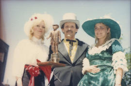 Three people wearing historical costumes