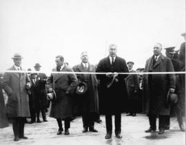 [Cutting the ribbon by Hon. W.H. Sutherland at the opening ceremony for the first Second Narrows ...