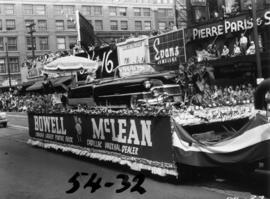 Bowell McLean car dealership float carrying Cadillac in 1954 P.N.E. Opening Day Parade