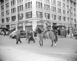 "[Woman riding a horse at Granville Street and Georgia to promote ""Trail Street"" at the ..."
