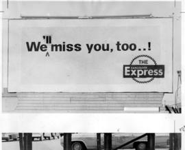 Billboard with Vancouver Express ad affixed