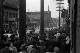 [Crowds on Pender Street during VJ Day celebrations]