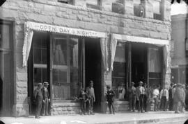 [Men and boy standing outside the Boulder Saloon (Boulder Hotel), 3 West Cordova Street, at the n...