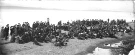 [Unidentified group sitting on beach]