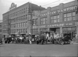 Anglo-Canadian Warehouse picnic [company vehicles decorated with banners and flags preparing to s...