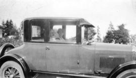 [L.D. Taylor and unidentified woman in car]