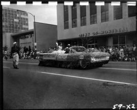 Miss Powell River on float in 1959 P.N.E. Opening Day Parade