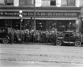 [Crowds assembled on sidewalk outside W. Woolworth Co. Ltd., on Hastings Street between Homer and...