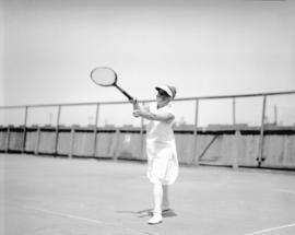 [Woman player at] tennis tournament