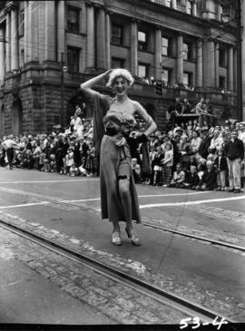 Man in drag in 1953 P.N.E. Opening Day Parade