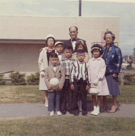 Lillian Ho Wong, Vernon and Paul Yee, flower girl Siane Wong, and other family members at a weddi...