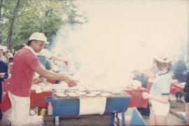 Man and child barbecuing