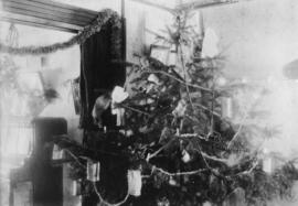 Interior of urban house with Christmas decorations and a Christmas tree