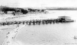 Card postmarked 1919; view looking east of English Bay Pier and beach